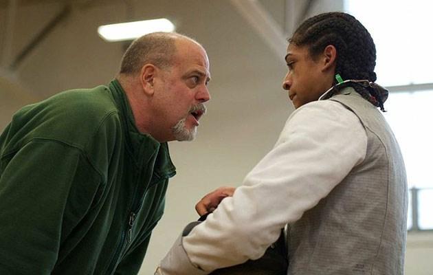 Michael Corona mentors a fencer during practice