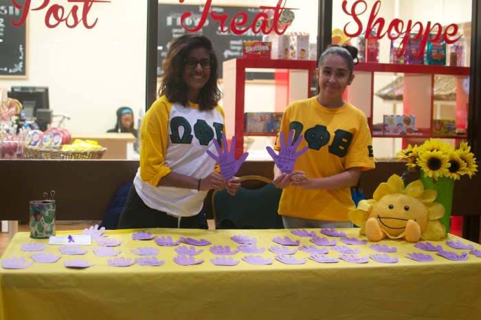 Sorority sisters of the Omega Phi Beta chapter on campus hold a philanthropic fundraiser outside of the Post Treat Shoppe