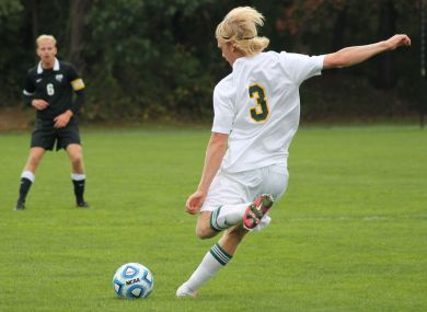 #3 Seb Baxter launches the ball to score for the Pioneers