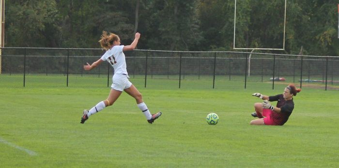 #11 forward Morgan Kitton makes a play to score