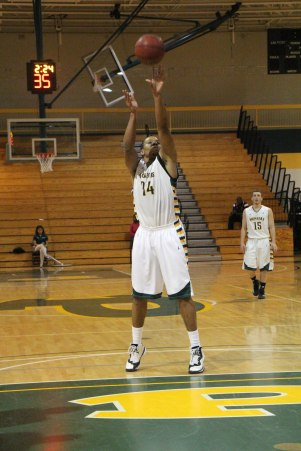 #34 Charles McCan shooting for 3. Photo credit: Kimberly Toledo