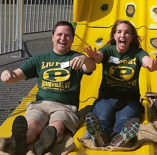Director of Campus Life Michael Berthel and Dean of Students Abby Van Vlerah slide into the spring semester. Photo credit: Tia-Moná Greene