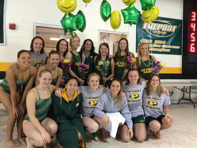 The team celebrates their final swim meet of the season. Photo credit: Kirsty Elliot
