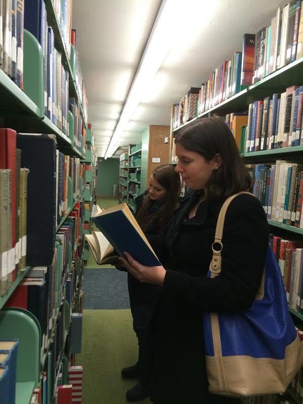 Graduate Nutrition majors Annemarie Miller and Sara Turnasella puruse the bookstacks in the library. Photo by Alyssa Seidman
