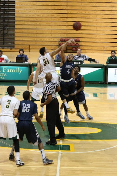 #33, sophomore forward Greg Dotson, tips off the match against Mercy. Photo: Kimberly Toledo