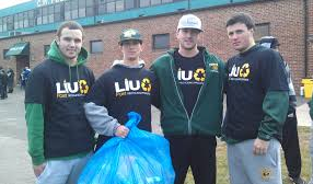Members of the Pioneer baseball team pitch in to reduce, reuse, and recycle. Photo from LIU.edu