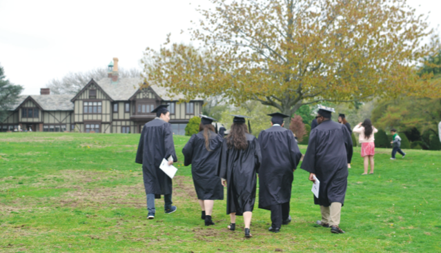 Post graduates cross the Great Lawn for one last time. Photo by Tia-Moná Greene