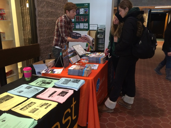 Students observe the many study abroad options offered through LIU Global. Photo: Melanie Spina