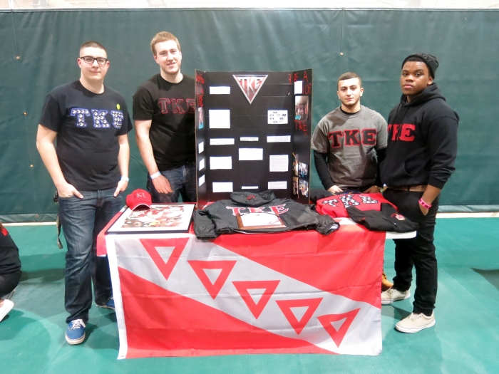 Brothers of Tau Kappa Epsilon hold an information table to recruit new pledge. Photo: Tia Mona Greene