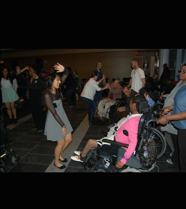 Members of the Newman Club dance the night away with patients afflicted with cerebral palsy at their third annual dance for the disease (2014.) Photo: Keanna Daly