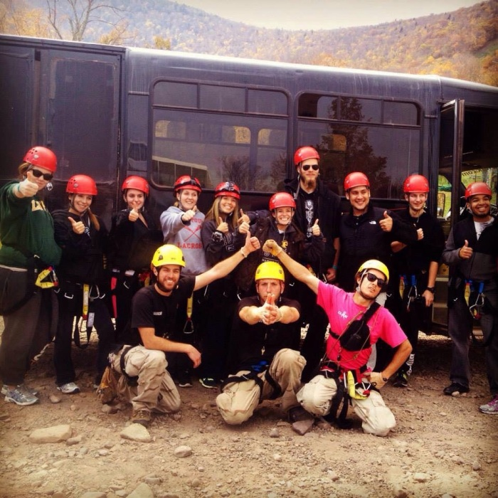 Post students pose with Delta X members on a zip lining trip.