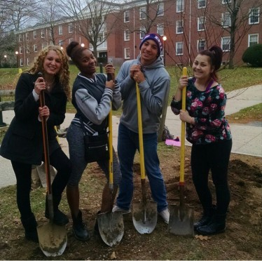 Professor Sassenoff's College 101 students plant a tree outside of Suffolk Hall. Photo: Tia Mona Greene