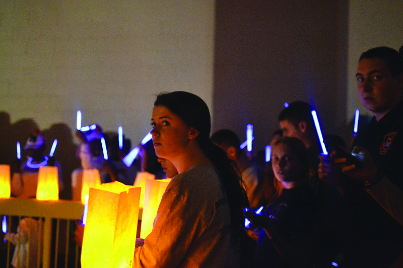 Students hold a luminary ceremony in honor of those battling cancer worldwide (2014.) Photo: Tia Mona Greene
