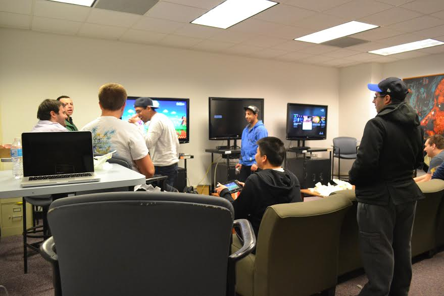 Students play video games in the Game Room. Photo: Tia-Mona Greene