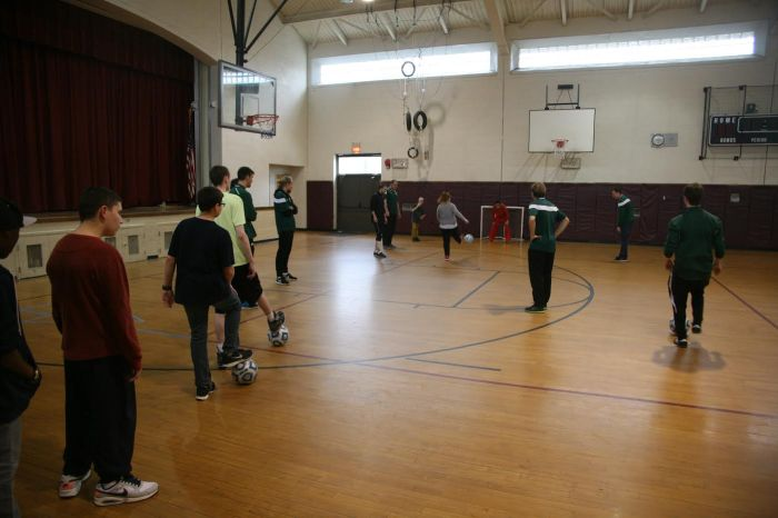 The men's soccer team runs drills with underserved children for community service. Photo: Seb Baxter