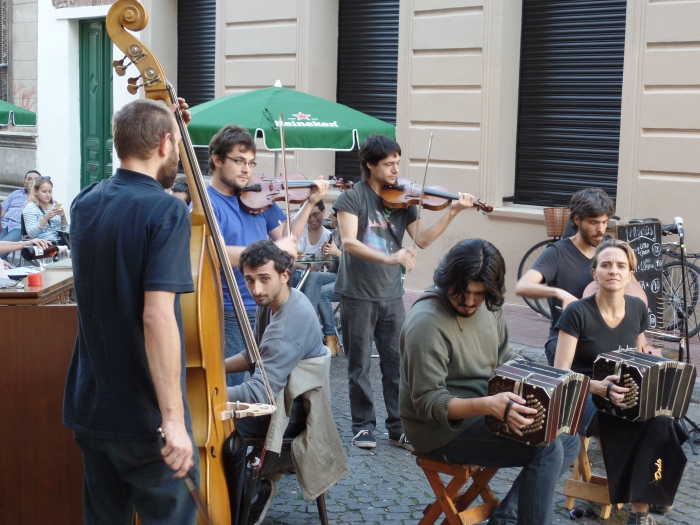Musicians playing tango on the streets of San Telmo, the oldest district in Buenos Aires